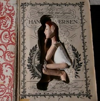 Altered book with handmade doll
